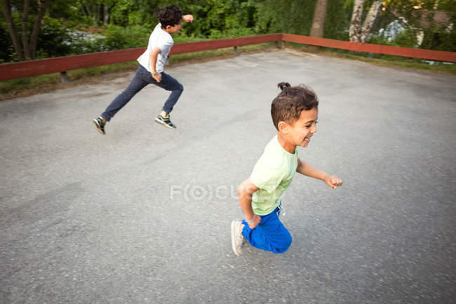 High angle view of children playing in yard — Stock Photo