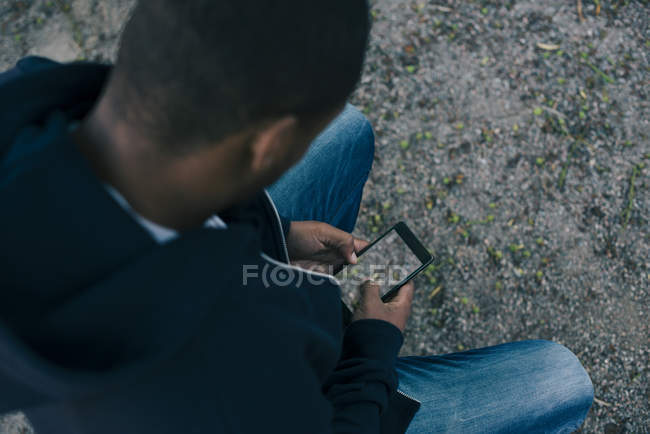 High angle view of man photographing ground from smart phone — Stock Photo