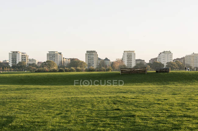 Distant view of residential quarter and green field at foreground — Stock Photo