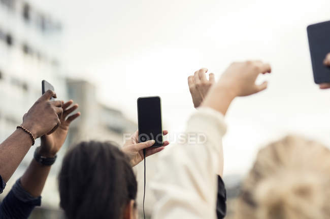High angle view of people using smartphone — Stock Photo