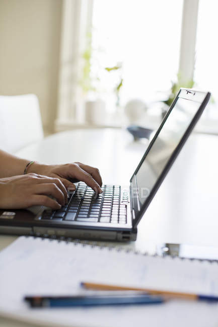 Cropped image of woman using laptop — Stock Photo