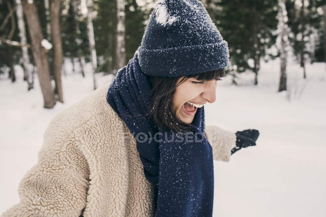Mid adult woman screaming while playing at park — Stock Photo