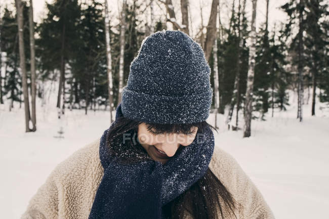 Smiling mid adult woman wearing knit hat and scarf during winter — Stock Photo