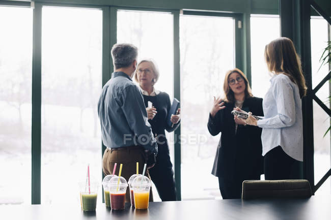 Business people sharing ideas in meeting at office — Stock Photo