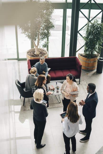 High angle view of business people discussing in meeting at office — Foto stock