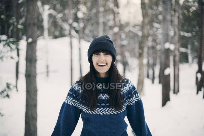 Portrait of smiling woman standing on snowy field during winter — Stock Photo