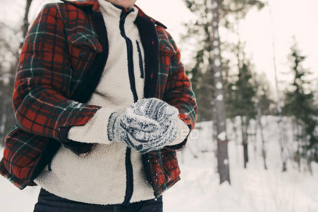 Midsection of man making snowball on snowy field at park — Stock Photo