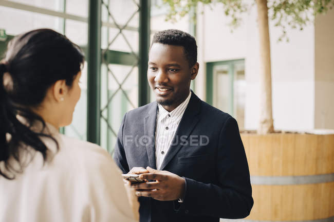 Businessman communicating with female coworker in meeting at office — Stock Photo