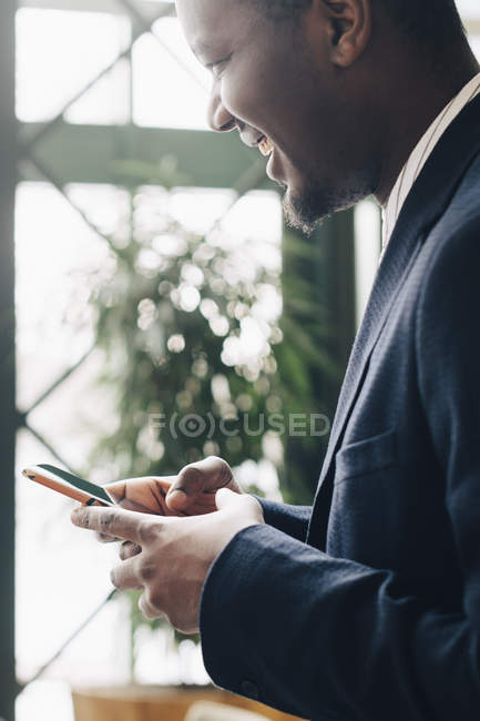 Businessman using mobile phone at office — Stock Photo