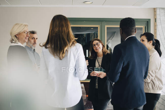 Multi-ethnic entrepreneurs discussing at conference — Stock Photo