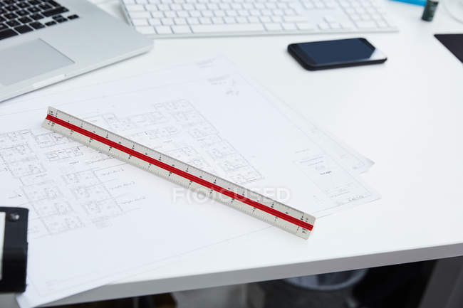 High angle view of blueprints with ruler at desk in creative office — Stock Photo