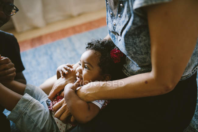 High angle view of baby girl with mother and father at home — Stock Photo