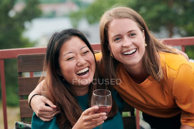 Cheerful friends enjoying party on terrace — Stock Photo