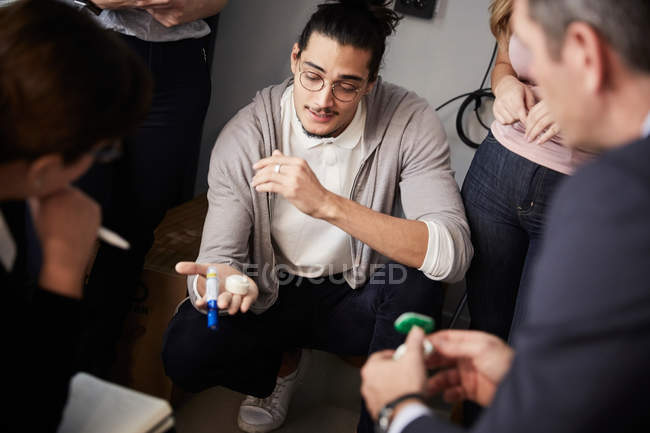 Creative businessman explaining project to bank managers during meeting in office — Stock Photo
