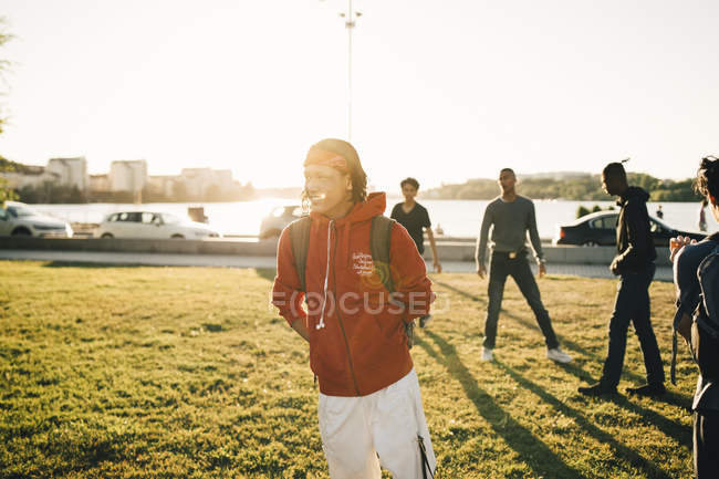 Male friends standing on field during sunny day — Stock Photo
