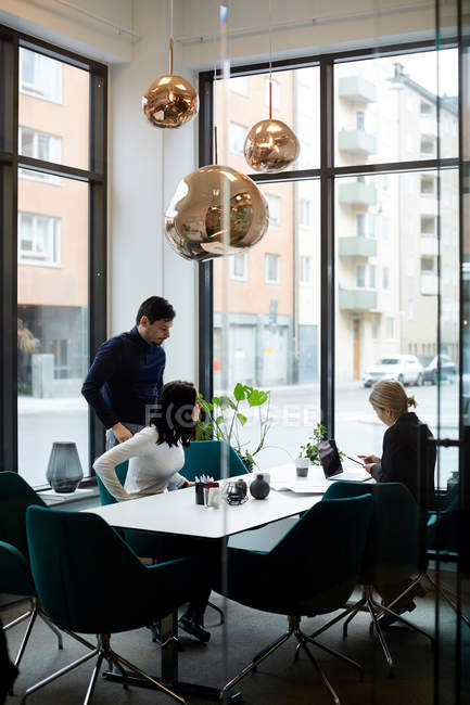 Couple visiting female real estate agent in office — Stock Photo