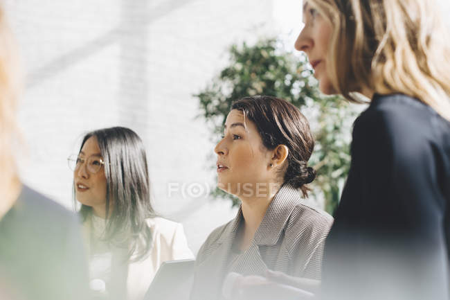 Female professionals networking in meeting at office — Stock Photo