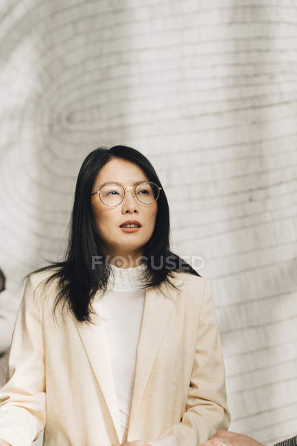 Thoughtful businesswoman looking away at conference event — Stock Photo