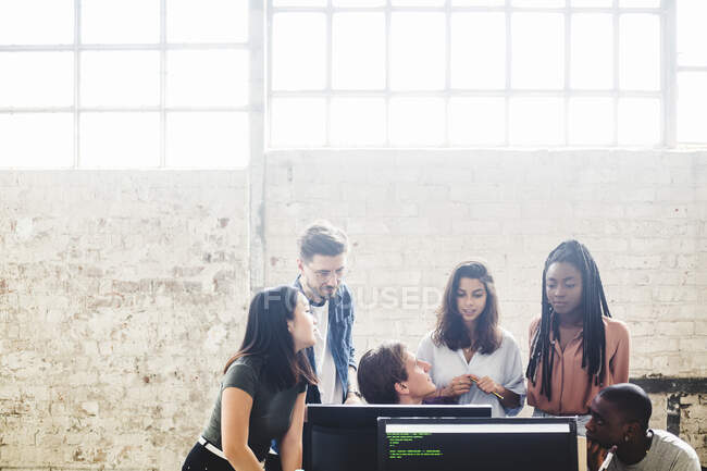 Professional programmers working in team while coding at creative workplace — Photo de stock