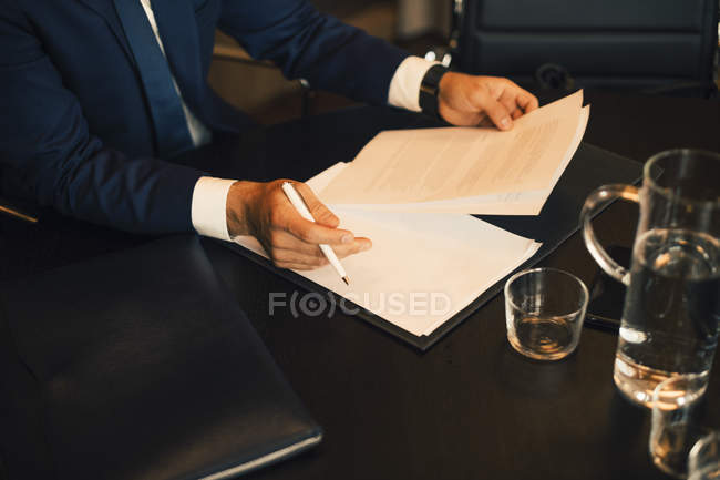 Midsection of lawyer reviewing evidence at legal office — Stock Photo