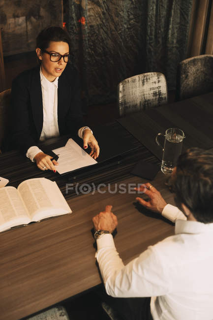 High angle view of client discussing problems with female lawyer in meeting — Stock Photo
