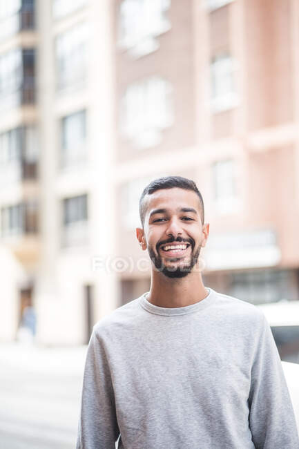 Portrait of smiling young man standing outdoors — Stock Photo