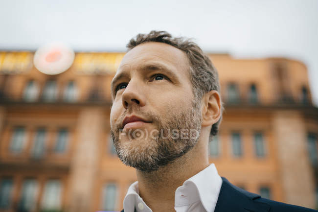 Close-up of thoughtful businessman looking away — Stock Photo
