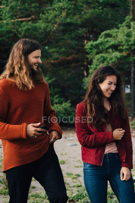 Happy friends spending leisure time together in forest — Stock Photo