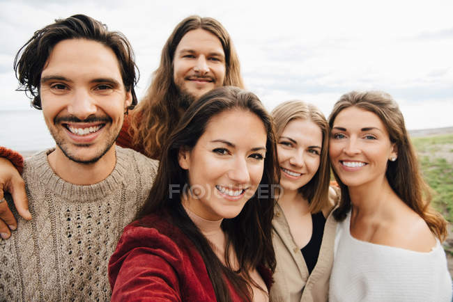 Portrait of happy friends against sky — Stock Photo