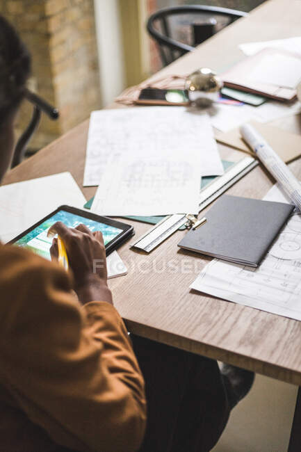 High angle view of female designer using digital tablet while sitting by desk at home office — Stock Photo