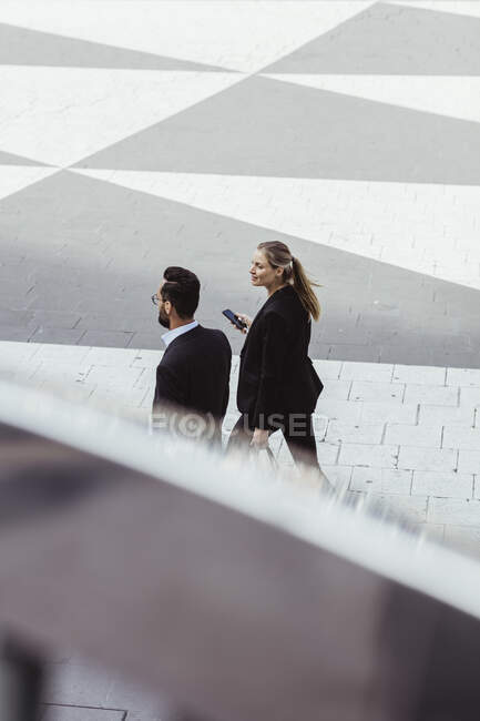 High angle view of business people walking and talking outdoors — Stock Photo