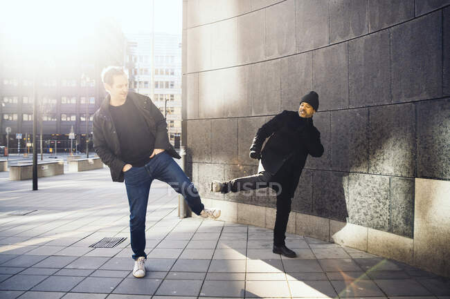 Two people greeting using feet — Stock Photo