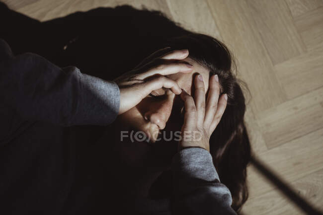 Close-up of stressed woman lying at home — Stock Photo