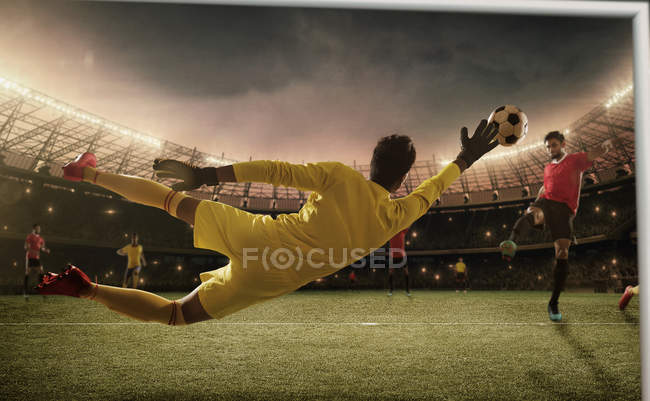 Football game moment with goalkeeper — Stock Photo