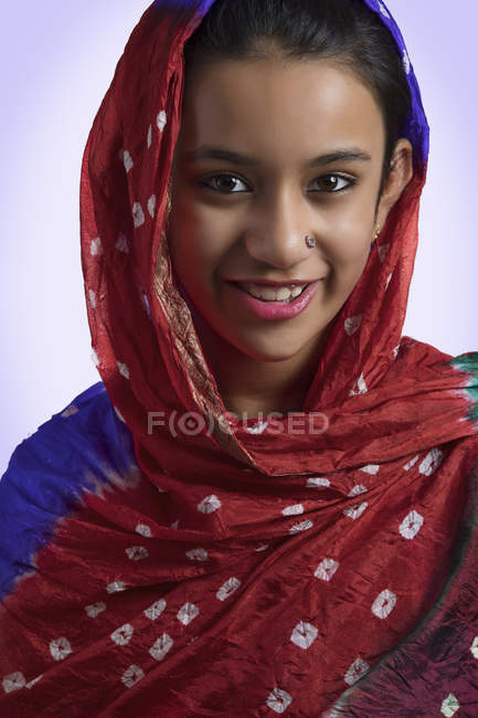 Portrait of Indian girl wearing duppatta on head — Stock Photo