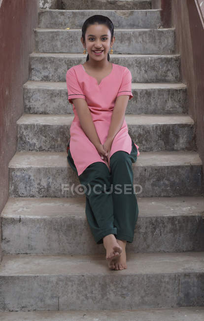 Portrait of Indian girl sitting on steps — Stock Photo