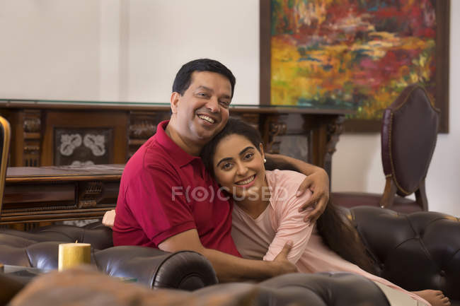Husband and wife sitting together at home — Stock Photo