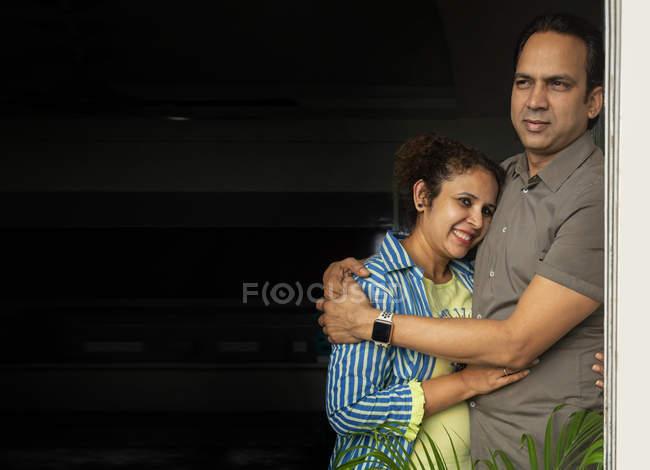 Young wife hugging her husband. - foto de stock