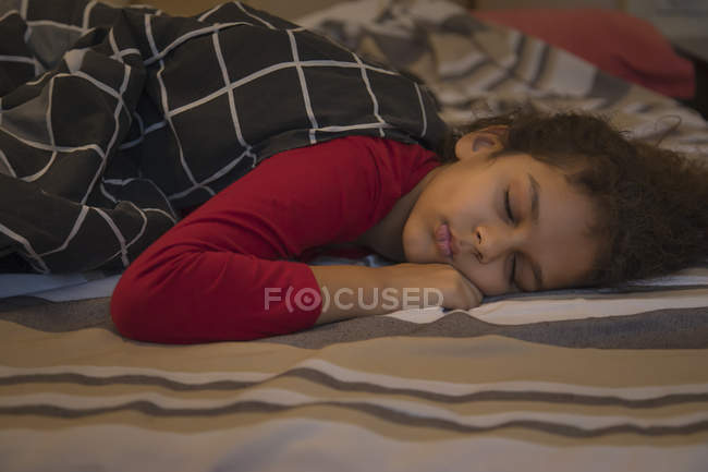 Young girl sleeping with a blanket. — Stock Photo
