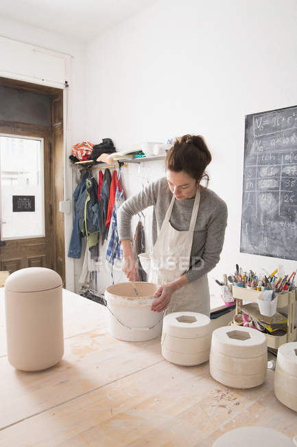 A ceramic artist is preparing the paste for slipcasting in a ceramic workshop. — Stock Photo