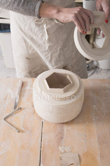 A ceramic artist is in the process of slipcasting ceramics in a pottery workshop. — Stock Photo