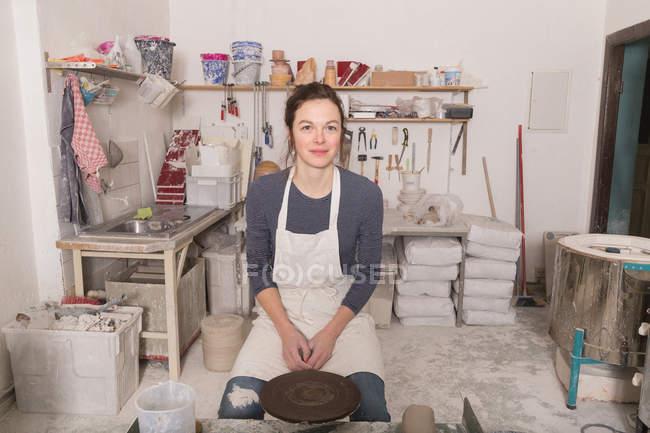 Caucasian woman seen in a ceramic workshop. — Stock Photo