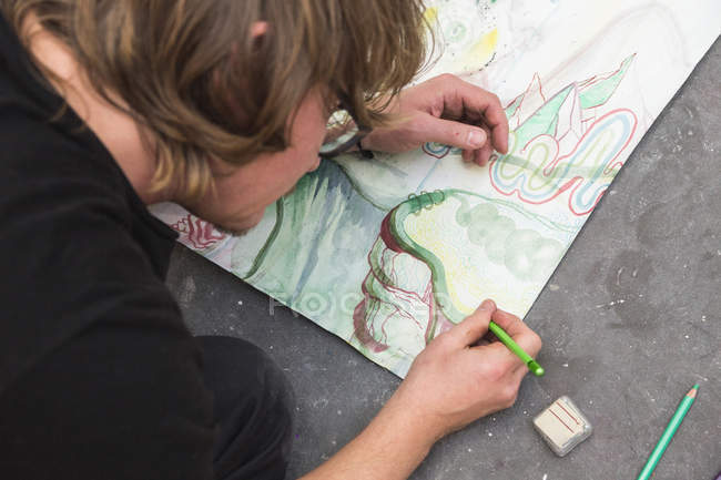 Overhead view of Creative artist working in his workshop. — Stock Photo