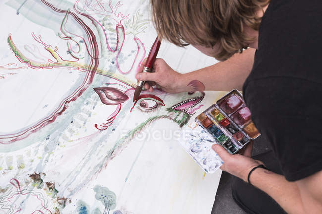 Overhead view of Creative male artist working in his workshop. — Stock Photo