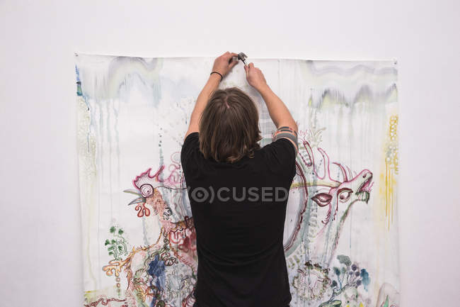 Creative male artist working in his workshop, rear view — Stock Photo