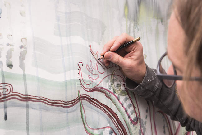 Cropped image of Creative male artist working in his workshop. — Stock Photo