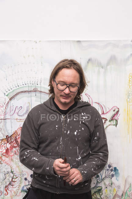 Front view of Creative male artist looking down — Stock Photo