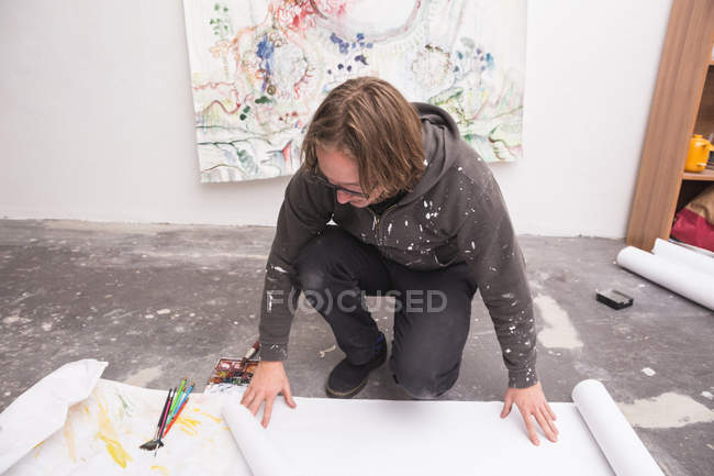 Creative male artist working in his workshop while looking down — Stock Photo