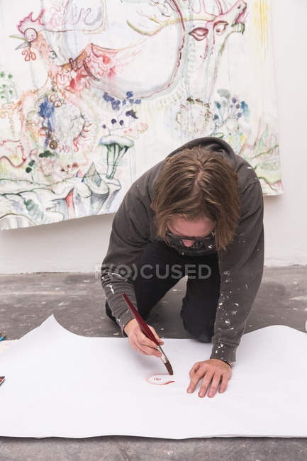 Front view of Creative male artist working in his workshop. — Stock Photo