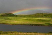 Rainbow over lake Snizort, Portree, Highland, Scotland, United Kingdom — Stock Photo